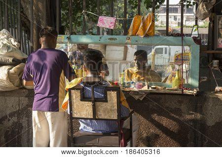 DELHI INDIA-JUL 25 : street barber shop in old delhi of delhi on july 25 2015.