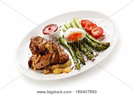 Grilled steak - fillet mignon with asparagus and boiled egg