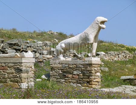 Ancient lion statue against the sunny sky, Archaeological Site of Delos, Delos Island, Mykonos, Greece