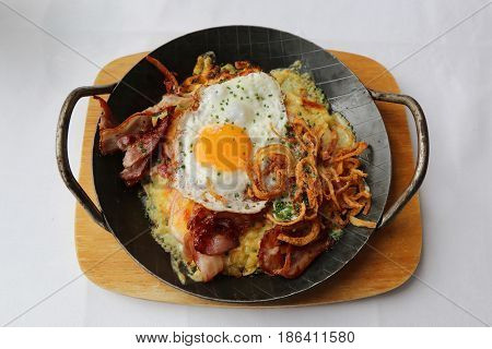 Traditional Swiss dish Rosti consisting mainly of potatoes, in the style of a fritter