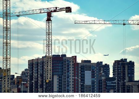 work the high crane at a construction site