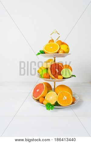 Different Citrus Fruit On Cake Stand With Copy Space