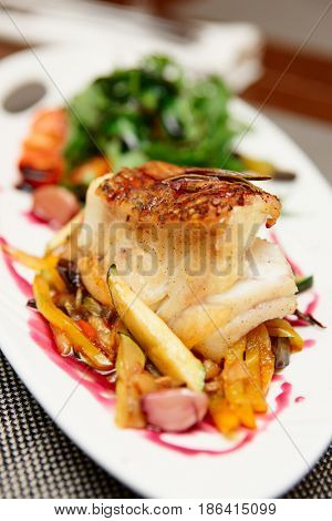 White fish fillet with vegetables, close-up