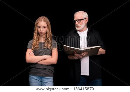 Grandfather And Granddaughter With Book