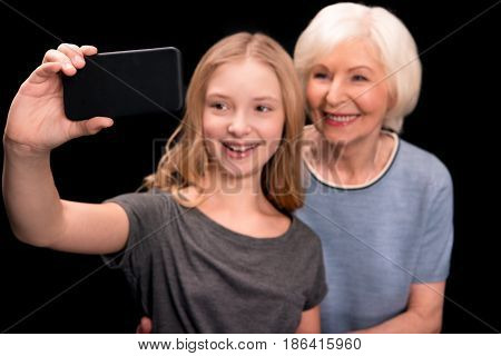 Grandmother And Granddaughter Taking Selfie