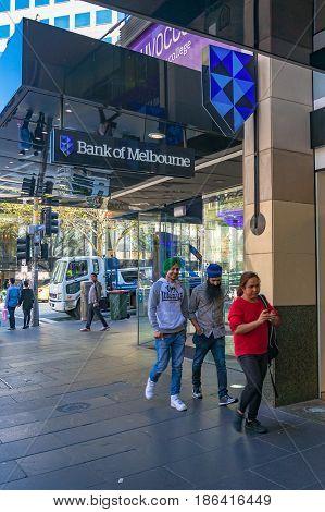 Smiling Sikh Men Going Past Bank Of Melbourne