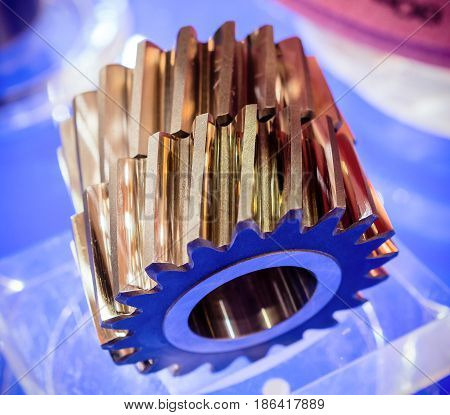 Helical gears close-up. Metal products, spare parts