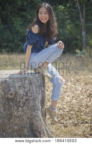 portrait of younger asian woman smiling face happiness emotion relaxing on traveling