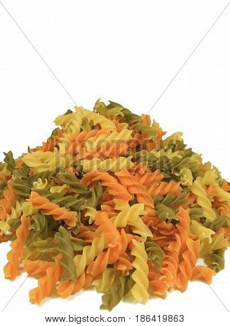 Uncooked Three-color Fusilli Pasta Piled-up on White Background, Vertical Front View Photo with Free Space for Text or Design