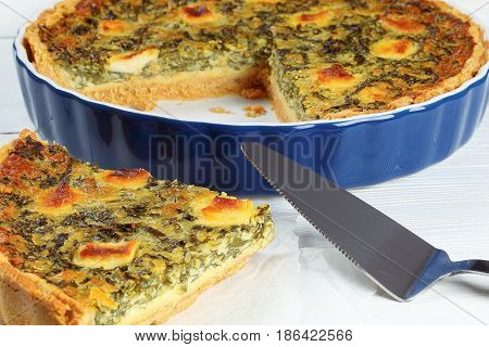 Quiche Florentine Cut In Slices In Baking Dish