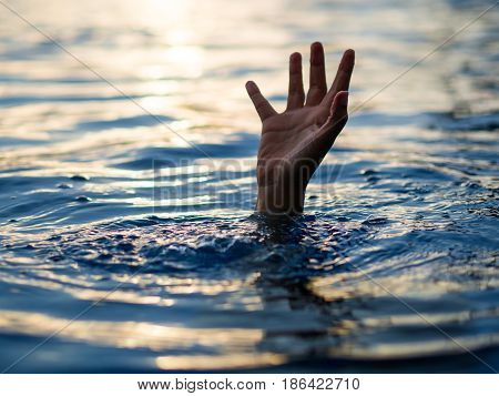 Drowning victims Hand of drowning man needing help. Failure and rescue concept.