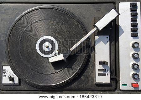Dirty obsolete retro vinyl player top view