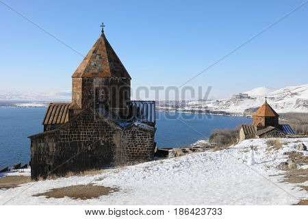 Lake Sevan, Surb Arakelots Church is ancient architectural monument of Armenia, 9th century, winter, town far away