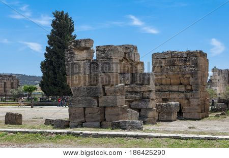 The elements of the wall of a ruined ancient house. Beautiful background of the ruins of Greek cities
