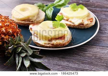 Toast Hawaii, , Cheese And Pineapple On Wooden Background With Chicken Breast