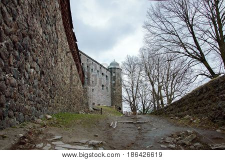 Historic Vyborg castle (Finnish, Swedish and Russian rule) on island in Gulf of Finland. Ancient fortifications of XIII century. Monuments of West European medieval military architecture.