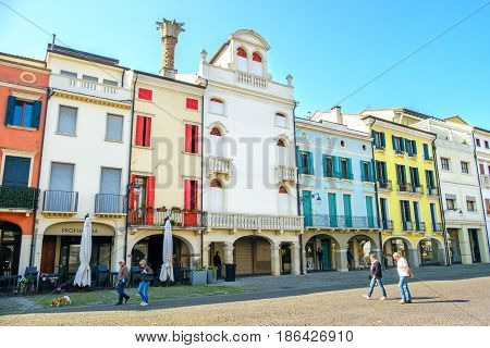 Este Italy 22 Apr 2017 - people walk under the colorful buildings in the main street of the italian Este village province of Padua