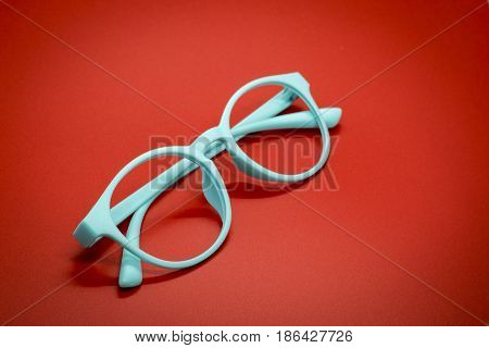 Modern fashionable spectacles on red background Glasses