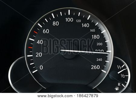 Driving very fast, speedometer showing 220
