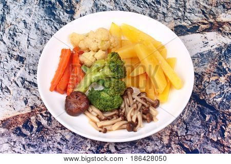 Food for health Fried sliced potato and Shimeji mushroom with mixed vegetables. No meat recipe.