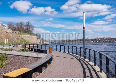 Quay along river in Narva town. Estonia Europe. Russian town Ivangorod at the distance