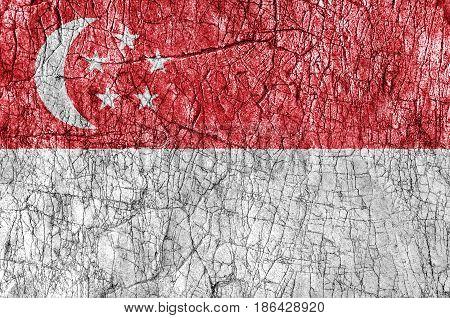 Grudge stone painted Singapore flag close up