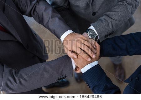 Close-up Partial View Of Businesspeople In Formal Wear Stacking Hands Together, Business Concept