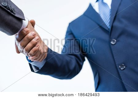 Close-up Partial View Of Businessmen Shaking Hands Isolated On White, Business Concept