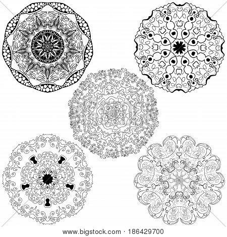 Vector set from five round black and white mandalas. Vector mandalas. Ethnic decorative elements. Hand drawn mandalas.