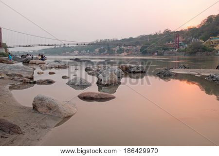 At the river Ganges near Laxman Jhula in India at sunset