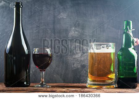 Glass of Beer and red wine with copy space for text on chalk board background