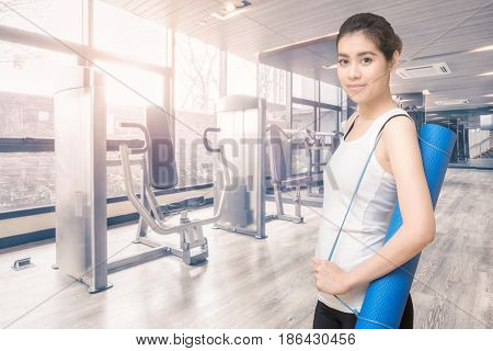 Asian Healthy Woman Ready To Exercising At Sport Gym, Girl Doing Sport Indoor.photo Design For Fitne