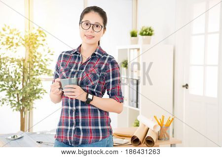 Chinese Female Architect Hold A Cup Of Coffee