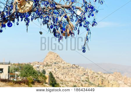 Nazars, Turkish Evil Eye Charms On The Tree. Cappadocia. Turkey