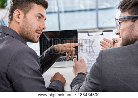Back View Of Successful Businessmen Discussing Job Interview Contender
