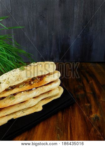 Flat bread topped with sunflower seeds and salt. Space for text.