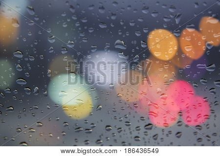 Water drop on window glass on blur light background