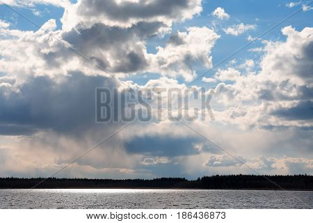 Gloomy sky background above lake and forest
