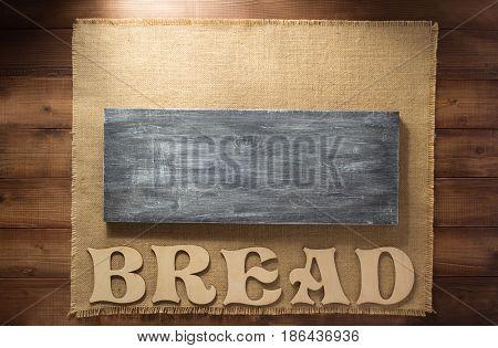 burlap hessian sacking on wooden background