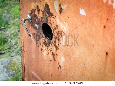 Selective focus of Old steel cabinet in the park