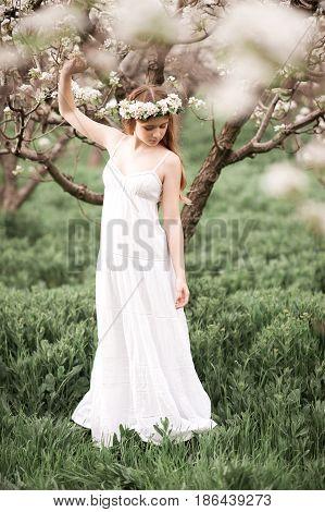 Beautiful teen girl 14-16 year old wearing stylish dress outdoors. Summer time.