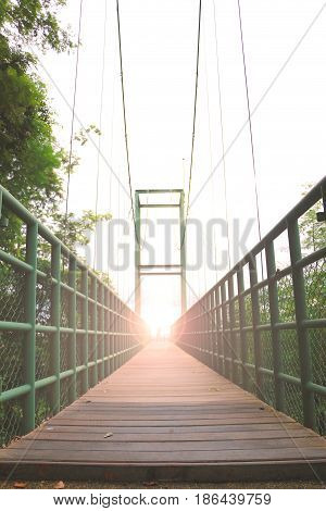 Steel bridge with wood floor.Sweetheart on the steel bridge with blurred style
