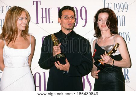 LOS ANGELES - APR 11:  Jennifer Lopez, Marc Anthony, Dayanara Torres at the Fourth Annual ALMA Awards at the Pasadena Civic Auditorium on April 11, 1999 in Pasadena, CA