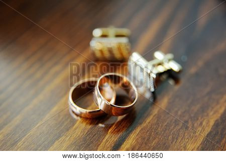wedding rings and cufflinks on the table