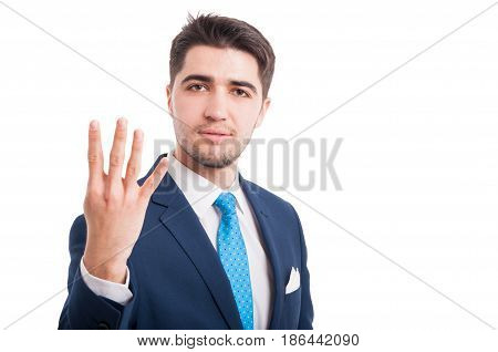 Handsome Young Man Counting Four Fingers