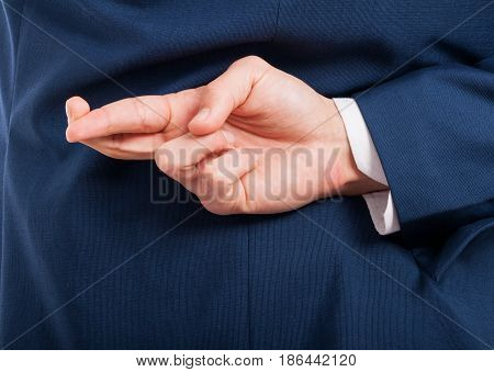 Closeup Of Man Hand Doing A Cheating Gesture