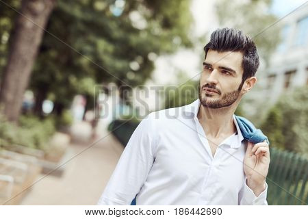 Outdoor portrait of handsome young man on the street.