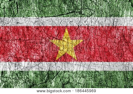 Grudge stone painted Suriname flag close up