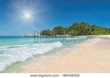 Sunset at tropical beach on Police bay, Seychelles.