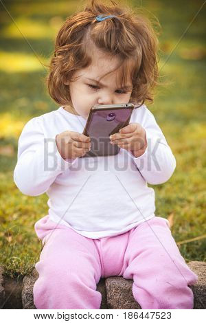 baby with mobile in park